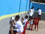 Dari Dinding Pelabuhan Larantuka,Para Pelajar Gaungkan Gerakan Bersih Laut dan Pantai